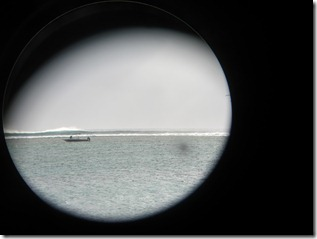 "Looking out at ""One Eye"" at Le Morne in Mauritius (shot with Cannon S90 through my binoculars)"
